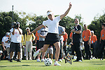 Suzann Pettersen kicks a football at the 14th hole during the World Celebrity Pro-Am 2016 Mission Hills China Golf Tournament on 22 October 2016, in Haikou, China. Photo by Weixiang Lim / Power Sport Images