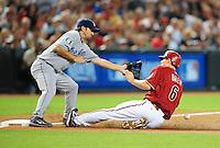 Jul 20, 2008; Phoenix, AZ, USA; Arizona Diamondbacks base runner Stephen Drew slides safely into third in the first inning as Los Angeles Dodgers third baseman Blake Dewitt catches the ball at Chase Field. Mandatory Credit: Mark J. Rebilas-