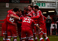 10th January 2021; Broadfield Stadium, Crawley, Sussex, England; English FA Cup Football, Crawley Town versus Leeds United; Ashley Nadesan of Crawley celebrates as he scores for 2-0 in the 53rd minute and is swamped by his team mates