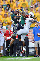 Baylor cornerback Xavien Howard (4) intercepts a pass intended for SMU wide receiver Darius Joseph (18) during first half of NCAA inaugural Football game at newly constructed McLean Stadium, Sunday, August 31, 2014 in Waco, Tex. Baylor leads SMU 31-0 in the first half. (Mo Khursheed/TFV Media via AP Images)