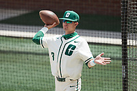 Dante DeFranco (3) of the Charlotte 49ers throws a football to stay loose between innings of the game against the Old Dominion Monarchs at Hayes Stadium on April 25, 2021 in Charlotte, North Carolina. (Brian Westerholt/Four Seam Images)