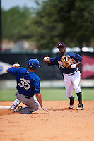 GCL Braves shortstop Nicholas Shumpert (92) throws to first as Matt Dean (35) slides into second base during a game against the GCL Blue Jays on August 5, 2016 at ESPN Wide World of Sports in Orlando, Florida.  GCL Braves defeated the GCL Blue Jays 9-0.  (Mike Janes/Four Seam Images)