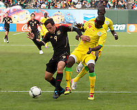 San Francisco, California - Saturday March 17, 2012: Jeronimo Amione and ElHadji Sady Gueye in action during the Mexico vs Senegal U23 in final Olympic qualifying tuneup. Mexico defeated Senegal 2-1