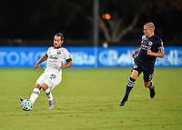 LAKE BUENA VISTA, FL - AUGUST 01: Sebastián Blanco #10 of the Portland Timbers passes the ball away from Alexander Ring #8 of New York City FC during a game between Portland Timbers and New York City FC at ESPN Wide World of Sports on August 01, 2020 in Lake Buena Vista, Florida.