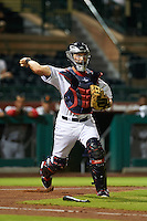 Scottsdale Scorpions catcher Jeremy Lucas (8) throws to first during an Arizona Fall League game against the Salt River Rafters on October 14, 2015 at Scottsdale Stadium in Scottsdale, Arizona.  Scottsdale defeated Salt River 13-3.  (Mike Janes/Four Seam Images)
