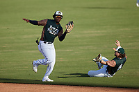 Charleston Boiled Peanuts shortstop Abiezel Ramirez (2) catches a pop fly in front of a sliding Brett Wisely (5) during the game against the Augusta GreenJackets at Joseph P. Riley, Jr. Park on June 26, 2021 in Charleston, South Carolina. (Brian Westerholt/Four Seam Images)