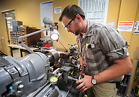 August 10, 2018. San Diego, CA. USA. |Bobby Mills works on the lathe in the lab ATA Engineering. | Photos by Jamie Scott Lytle, copyright.