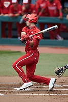 Luca Tresh (24) of the North Carolina State Wolfpack follows through on his swing against the North Carolina Tar Heels at Boshamer Stadium on March 27, 2021 in Chapel Hill, North Carolina. (Brian Westerholt/Four Seam Images)
