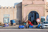 Essaouira, Morocco.  Bab Marrakesh.  Porters with their Carts bring Tourists' Luggage to their Waiting Bus; Motorized Vehicles not allowed inside the Medina.