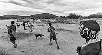 One of the more unique experiences on this trip involved joining a nomadic Hadzabe (Hadza) tribe. They will purportedly catch and eat any sort of game. We were fortunate that they caught a Guinea Fowl during our hunt with them. Even though there were eight men and it was the only food caught, they still shared with us.