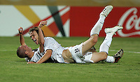 The United States' Brian Ownby (15) celebrates with teammate Jared Jeffrey, (8) after the forth goal against  Cameroon during the FIFA Under 20 World Cup Group C Match between the United States and Cameroon at the Mubarak Stadium on September 29, 2009 in Suez, Egypt.