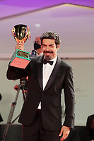 VENICE, ITALY - SEPTEMBER 12: Pierfrancesco Favino poses with the Coppa Volpi for Best Actor during the winners photocall at the 77th Venice Film Festival on September 12, 2020 in Venice, Italy.  <br /> CAP/MPI/AF<br /> ©AF/MPI/Capital Pictures