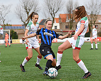 OHL's Marith De Bondt pictured defending on Celien Guns (10 Brugge) and OHL's Jill Janssens during a female soccer game between Club Brugge Dames YLA and Oud Heverlee Leuven on the 8 th matchday of the 2020 - 2021 season of Belgian Scooore Womens Super League , saturday 21 th November 2020  in Knokke , Belgium . PHOTO SPORTPIX.BE | SPP | DAVID CATRY