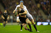 Kieran Read of New Zealand is tackled by Mike Brown of England during the QBE Autumn International match between England and New Zealand at Twickenham on Saturday 01 December 2012 (Photo by Rob Munro)