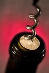 Corkscrew opens bottle of wine