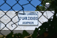 "Pictured: The 6th Primary School in Acharnes, Athens, Greece. Friday 09 June 2017<br /> Re: An 11 year old boy has been shot dead by a ""stray bullet"" during a school celebration in Acharnes (Menidi) area, in the outskirts of Athens, Greece.<br /> Marios Dimitrios Souloukos ""complained to his mum"" who works as a teacher at the 6th Primary School of Acharnes that he was feeling unwell, he then collapsed with blood pouring out from the top of his head.<br /> His mum tried to revive him assisted by other teachers while his schoolmates who were reportedly upset, were hurriedly removed by their parents.<br /> According to locals an ambulance arrived 25 minutes late.<br /> Hundreds of police officers have been deployed in the area and have raided many properties.<br /> Shells matching the fatal bullet which hit the boy on the top of his head were found in a house yard nearby.<br /> Local people reported hearing shots being fired at a nearby Romany Gypsy camp before the fatal incident.<br /> The area has been plagued with criminality during the last few years."