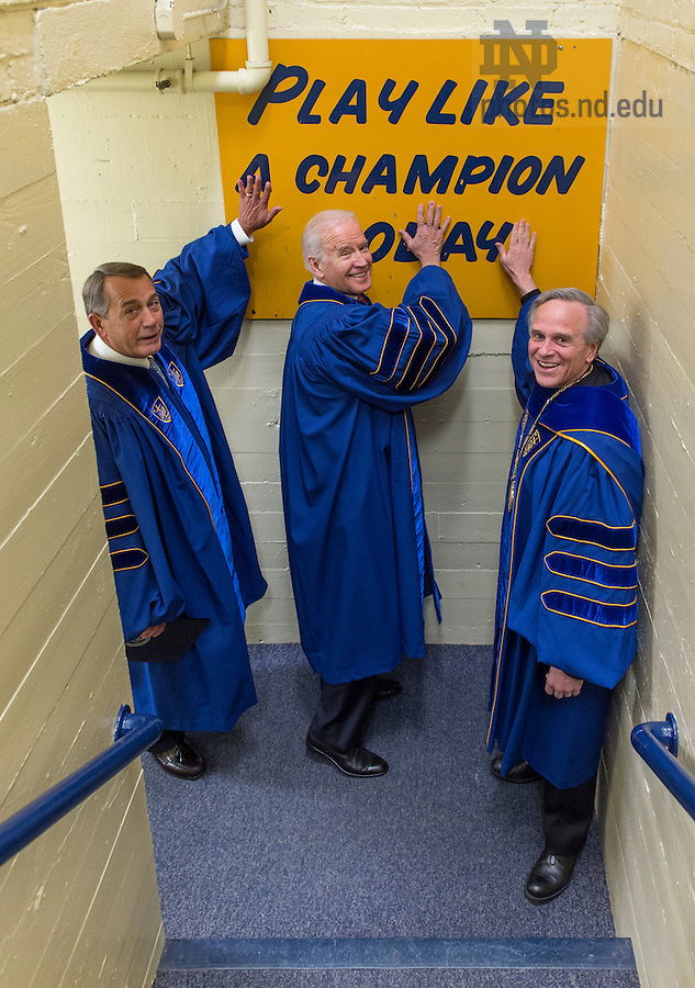 May 15, 2016; University of Notre Dame president Rev. John Jenkins, C.S.C. and Laetare Medal recipients, John Boehner, former Speaker of the House and Vice President Joe Biden, touch the Play Like a Champion sign on their way out of the locker room for the 2016 Commencement Ceremony at Notre Dame Stadium. (Photo by Barbara Johnston/University of Notre Dame)