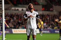Saturday 28 September 2013<br /> Pictured: A disappointed Michu of Swansea after the final whstle<br /> Re: Barclay's Premier League, Swansea City FC v Arsenal at the Liberty Stadium, south Wales.