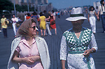 Coney Island New Jersey USA Circa 1970. Two women on vacation, one wears a popular and fashionable sun shield for her nose.