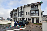 "Pictured: Part of a roof has blown off a block of flats in Penny Point, Pembroke Dock, west Wales. Monday 16 October 2017<br /> Re: Remnants of Hurricane Ophelia are expected to bring strong gusts of wind to Wales when it hits Britain's shores.<br /> The hurricane, making its way from the Azores in the Atlantic Ocean, will have weakened to a storm when it arrives.<br /> A Met Office amber ""be prepared"" warning has been issued in some areas bringing ""potential danger to life""."