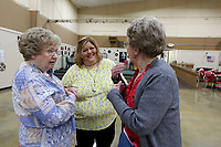Chris Price (left) and Kay Hodel (right) speak with Lori Proud, director of the Springdale Senior Activity and Wellness Center, Monday, May 3, 2021, on the first day of resuming full activities and services at the center in Springdale since the beginning of the pandemic. Proud described seeing everyone again as it's like the first day of school. Check out nwaonline.com/210504Daily/ and nwadg.com/photos for a photo gallery.<br /> (NWA Democrat-Gazette/David Gottschalk)