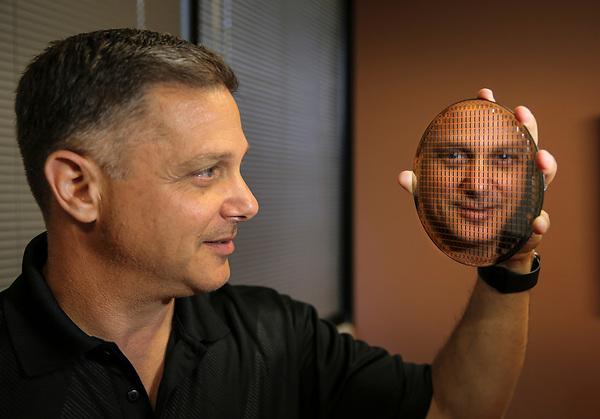 August 18, 2017. San Diego, CA. USA. |Dodo OmniData's CEO holds an etched silicon wafer. Jim Linton (CEO), Paul Predki (CTO), Stephanie George (CFO) |Photos by Jamie Scott Lytle. Copyright.
