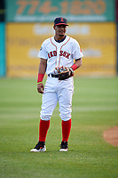 Salem Red Sox shortstop Santiago Espinal (5) warms up before a game against the Lynchburg Hillcats on May 10, 2018 at Haley Toyota Field in Salem, Virginia.  Lynchburg defeated Salem 11-5.  (Mike Janes/Four Seam Images)