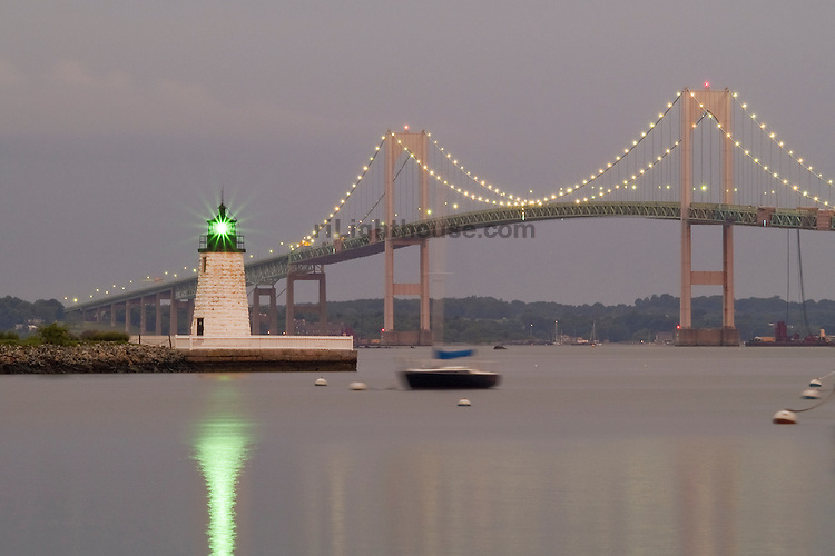 Lights sparkle one summer morning while viewing the Newport Bridge and Goat Island Light