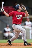 Huntsville first baseman Brad Nelson follows through on his swing versus Carolina at Five County Stadium in Zebulon, NC, Wednesday, July 19, 2006.
