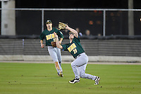 Siena Saints outfielder Carlos Tapia (29) catches a fly ball as Dan Swain (22) backs up the play during the opening game of the season against the UCF Knights on February 13, 2015 at Jay Bergman Field in Orlando, Florida.  UCF defeated Siena 4-1.  (Mike Janes/Four Seam Images)