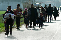 Pictured: Migrants arrive to the camp on foot Tuesday 01 March 2016<br />