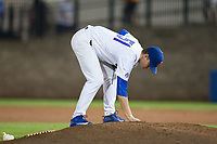 Florida Gators relief pitcher Brady Singer (51) fixes the dirt on the mound during the game against the Wake Forest Demon Deacons in Game One of the Gainesville Super Regional of the 2017 College World Series at Alfred McKethan Stadium at Perry Field on June 10, 2017 in Gainesville, Florida.  The Gators defeated the Demon Deacons 2-1 in 11 innings.  (Brian Westerholt/Four Seam Images)
