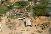 Pará State, Brazil. Aerial view of São Félix do Xingu showing charcoal burners next to a loggers sawmill.
