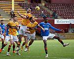 17.01.2021 Motherwell v Rangers: Tony Watt, Declan Gallagher and Jake Carroll clear from Joe Aribo