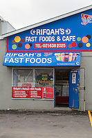 South Africa, Cape Town.  Fast Food Store Offering Halaal (Islamic-approved) Food and Snacks.  Note Metal Security Gates.