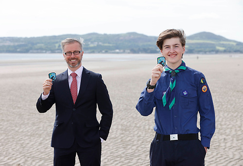 Minister for Children, Equality, Disability, Integration and Youth, Roderick O'Gorman helped by local Portmarnock Scout Rohan Belgan (age 14) on Portmarnock Beach