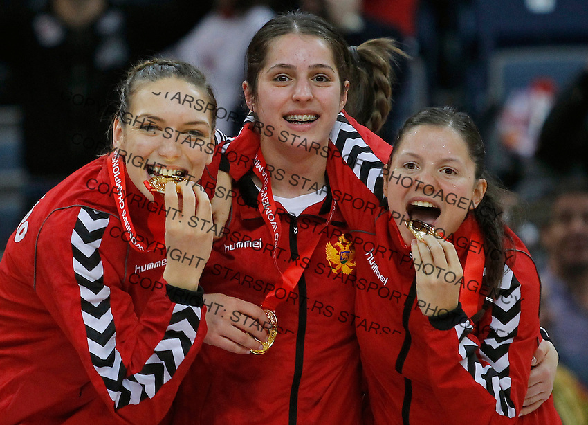 BELGRADE, SERBIA - DECEMBER 16: Montenegro handball team celebrate with medals during the Women's European Handball Championship 2012 medal ceremony at Arena Hall on December 16, 2012 in Belgrade, Serbia. (Photo by Starsportphoto.com)