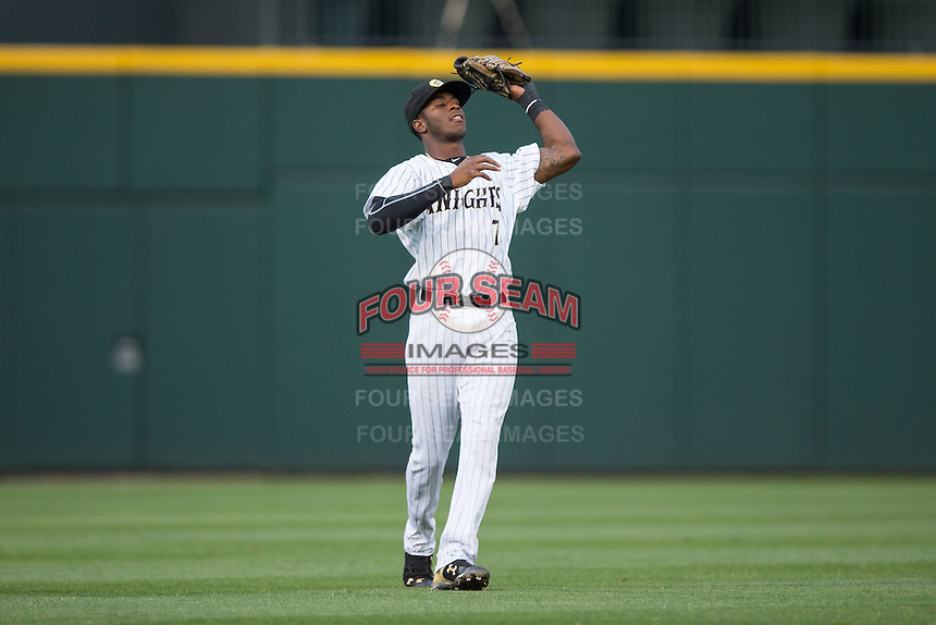 Charlotte Knights shortstop Tim Anderson (7) catches a fly ball in shallow left field during the game against the Syracuse Chiefs at BB&T BallPark on June 1, 2016 in Charlotte, North Carolina.  The Knights defeated the Chiefs 5-3.  (Brian Westerholt/Four Seam Images)