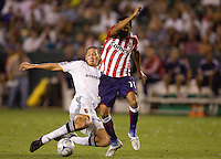 LA Galaxy defender Omar Gonzalez tackles Chivas USA forward Maykel Galindo. The LA Galaxy defeated Chivas USA 1-0 to win the final edition of the 2009 SuperClásico at Home Depot Center stadium in Carson, California on Saturday, August 29, 2009...