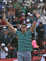 BOGOTA – COLOMBIA – 20-07-2014: Bernard Tomic de Australia celebra despues de vencer a Ivo Karlovic de Croacia, durante partido de la final del Open Claro Colombia de tenis ATP 250, que se realiza en las canchas del Centro de Alto Rendimiento en Altura en la ciudad de Bogota. / Bernard Tomic of Australia celebrates after defeating / Ivo Karlovic of Croatia, during a match for the final of the Open Claro Colombia de tenis ATP 250, at Centro de Alto Rendimiento en Altura in Bogota City. Photo: VizzorImage / Luis Ramirez / Staff.