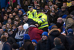 Dundee v St Johnstone….31.12.16     Dens Park    SPFL<br />A siants fan is escorted out by police<br />Picture by Graeme Hart.<br />Copyright Perthshire Picture Agency<br />Tel: 01738 623350  Mobile: 07990 594431