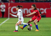 CARSON, CA - FEBRUARY 7: Jacqueline Ovalle #11 of Mexico nutmegs Kelley O'Hara #5 of the United States during a game between Mexico and USWNT at Dignity Health Sports Park on February 7, 2020 in Carson, California.