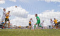 The ball flashes across the Notts County penalty area during the Sky Bet League 2 match between Newport County and Notts County at Rodney Parade, Newport, Wales on 30 April 2016. Photo by Mark  Hawkins / PRiME Media Images.