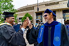 May 20, 2018; Marshall and Mendoza College of Business professor Chad Harms greets graduates as they enter Notre Dame Stadium for Commencement 2018. (Photo by Matt Cashore/University of Notre Dame)