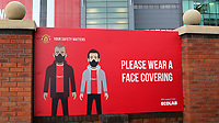 General view of a large sign on the approach to Old Trafford which reads, please wear a face covering, as football clubs continue to observe the Covid guidelines during Manchester United vs Brentford, Friendly Match Football at Old Trafford on 28th July 2021