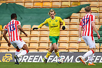 13th February 2021; Carrow Road, Norwich, Norfolk, England, English Football League Championship Football, Norwich versus Stoke City; Todd Cantwell of Norwich City is closed down by Mikel John Obi and Nathan Collins of Stoke City