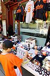 21 May 2007:  A baseball fan looks at some of the souvenirs available from vendors in celebration of the upcoming induction of Cal Ripken Jr. into the Baseball Hall of Fame Museum in Cooperstown, NY...Mandatory Credit: Ed Wolfstein Photo