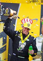 Sep 25, 2016; Madison, IL, USA; NHRA pro stock driver Alex Laughlin celebrates after winning the Midwest Nationals at Gateway Motorsports Park. Mandatory Credit: Mark J. Rebilas-USA TODAY Sports
