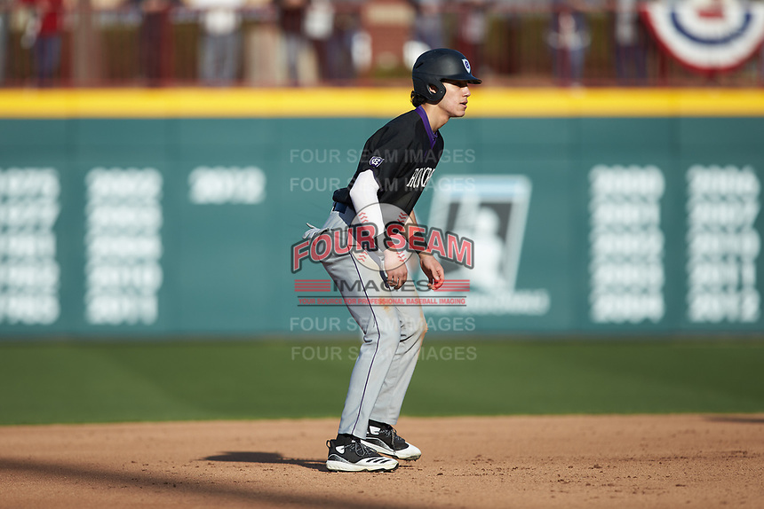 David Kale (12) of the Holy Cross Crusaders takes his lead off of second base against the South Carolina Gamecocks at Founders Park on February 15, 2020 in Columbia, South Carolina. The Gamecocks defeated the Crusaders 9-4.  (Brian Westerholt/Four Seam Images)