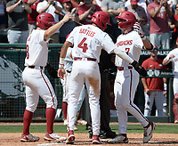 Arkansas third baseman Cayden Wallace (7) is congratulated at the plate Friday, June 4, 2021, after hitting a three-run home run by left fielder Braydon Webb (left) and shortstop Jalen Battles (4) during the fourth inning of the Razorbacks' 13-8 win over New Jersey Institute of Technology in the first game of the NCAA Fayetteville Regional at Baum-Walker Stadium in Fayetteville. Visit nwaonline.com/210605Daily/ for today's photo gallery.<br /> (NWA Democrat-Gazette/Andy Shupe)